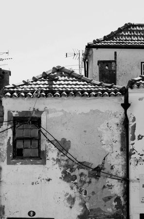 negligent: View of some abandoned and old houses on a city.