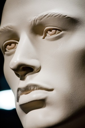 mannequin head: Close up view of the face of a male doll on the clothes store.