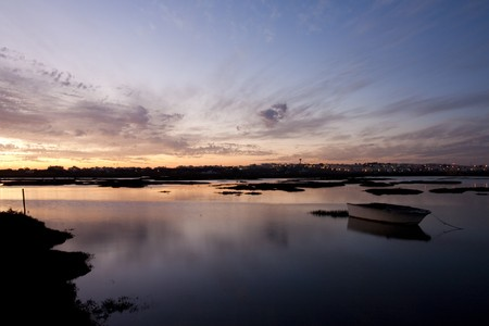 region of algarve: View of a beautiful sunset on the Ria Formosa region on the Algarve, Portugal.