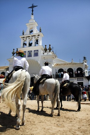 Partial view of the beautiful church of El Rocio in Spain, where a festivity is taking place. Stock Photo