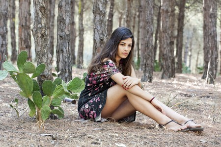 hot chick: Beautiful girl with floral dress posing on a forest.