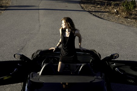view of a beautiful woman inside a sports car. photo