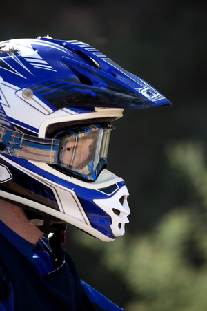 supercross: Close view of a motocross rider with helmet. Stock Photo
