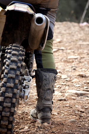 mx: Close view of the details of a motocross rider.