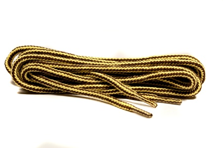 fash: Close view detail of the cords for shoes isolated on a white background.