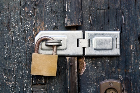 Close up view of a lock on old wooden door. photo