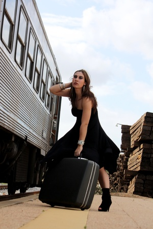 View of a beautiful woman with black dress upset with not catching the train Stock Photo - 9053467