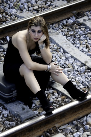 View of a beautiful woman with black dress upset with not catching the train Stock Photo - 9053142