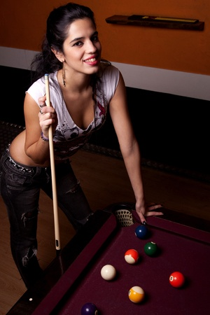 Detail view of a girl next to a snooker table. photo