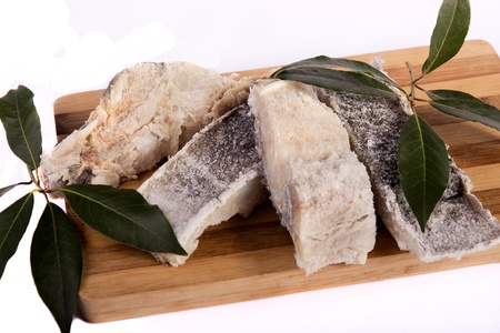 View of a bunch of sliced salted codfish isolated on a white background.