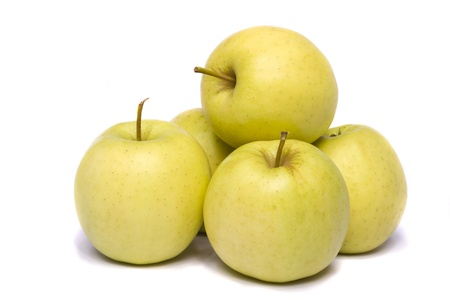 Close view of a bunch of yellow ginger gold variety type apples isolated on a white background. Foto de archivo
