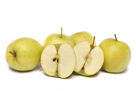 Close view of a bunch of yellow ginger gold variety type apples isolated on a white background. Stock Photo - 9940542