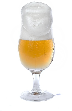 Close view of a glass of beer isolated on a white background. Stock Photo - 9942772
