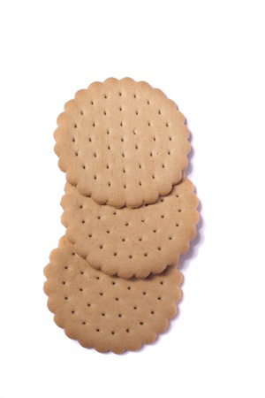 View of three round biscuits isolated on a white background. Stock Photo - 9942747