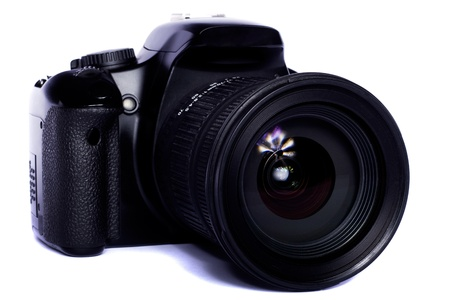 Close view of a modern photographic DSLR camera isolated on a white background. Stock Photo - 9940681