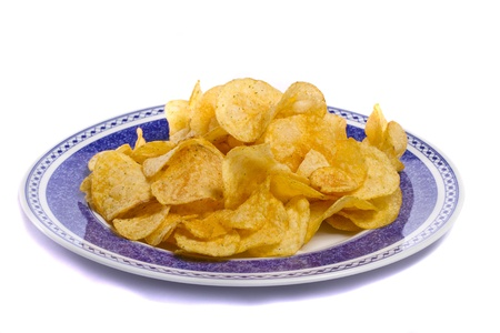 Close view of a bunch of  potato chips isolated on a white background. photo