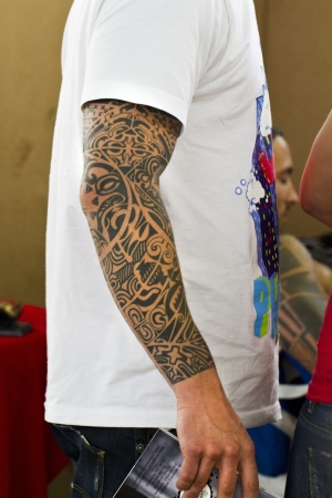 Close up view a man with a tattoo arm.