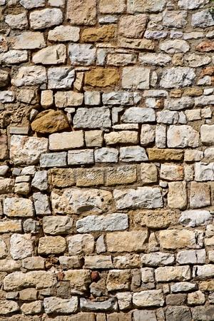 Close up view of a ancient brick wall.