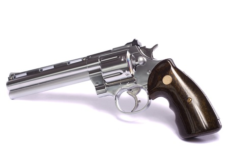 barrel pistol: Close up view of a airsoft gun isolated on a white background.