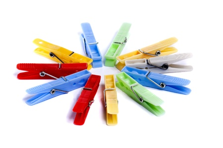 Close up view of some colorful cloth pegs isolated on a white background. photo