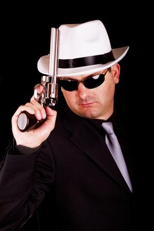 View of a dark suit gangster man holding a gun. Stock Photo - 9941805