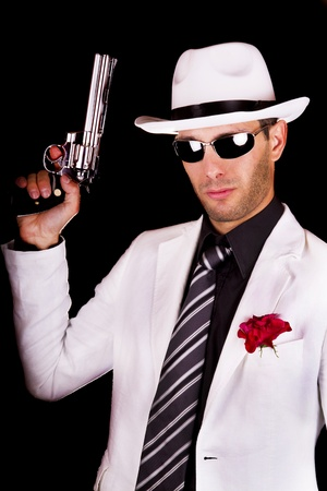 View of a white suit gangster man holding a gun. Stock Photo - 9941548