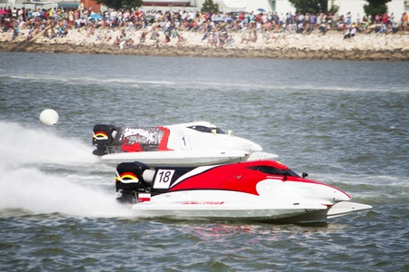 View of two powerboats racing on a lake in Portugal.