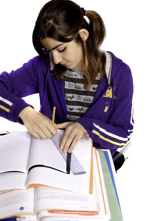 overweight students: View of a teenager school girl studying on a white background.