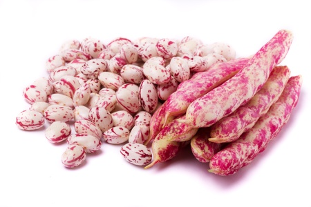 Close detail view of borlotti beans isolated on a white background.