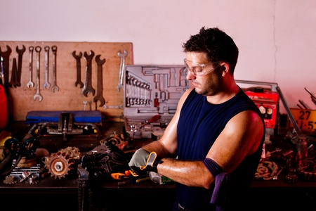 View of a garage mechanic man putting some protective gloves. Stock Photo - 10544342