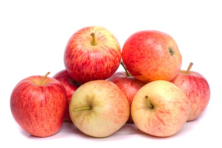 Close up view of a bunch of royal gala apples isolated on a white background.