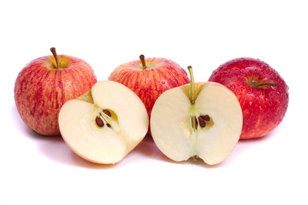 Close up view of some fresh royal gala apples isolated on a white background.