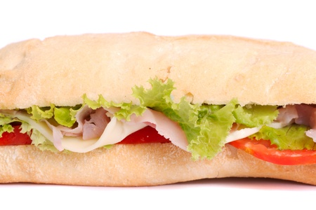 Close view of a fresh tasty ciabatta sandwich with tomato, lettuce, cheese and ham isolated on a white background. photo