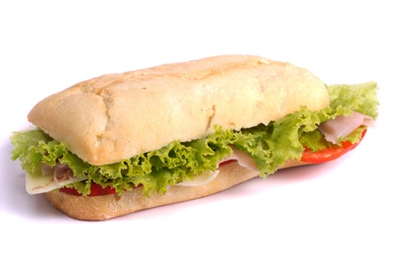 Close view of a fresh tasty ciabatta sandwich with tomato, lettuce, cheese and ham isolated on a white background.