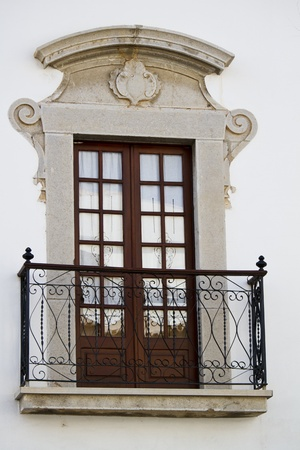 Close detail view of a Portuguese window of a building.  photo