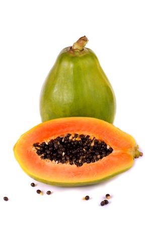 Close up view of a tropical papaya fruit isolated on a white background.