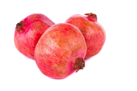 Close up view of some pomegranate fruit  isolated on a white background. Stock Photo - 12210013