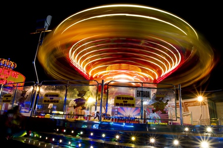 View of a amusement park ride in motion at night. Stock Photo - 12212771