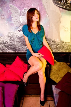 View of a beautiful young girl on a blue dress inside a bar pub. Stock Photo - 12210580