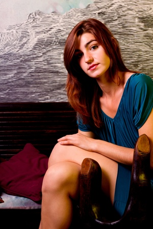 View of a beautiful young girl on a blue dress inside a bar pub. Stock Photo - 12212122