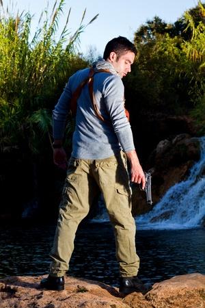 water gun: View of an treasure hunter, jungle adventurer type man.