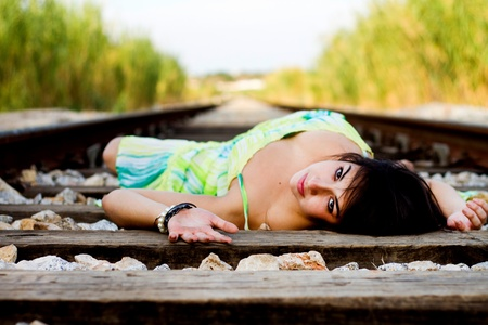 View of a beautiful girl with a spring dress on a railway. Stock Photo - 12211670