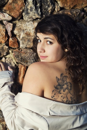 View of a beautiful girl showing her tattoo. photo