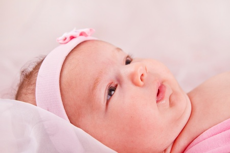 View of a newborn baby on smooth bed. Stock Photo - 12213575