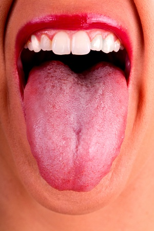 Close view detail of a woman with her tongue out. Stock Photo