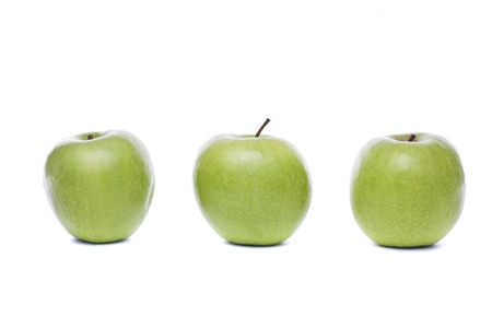 Close view of three  fresh green apples isolated on a white background. photo