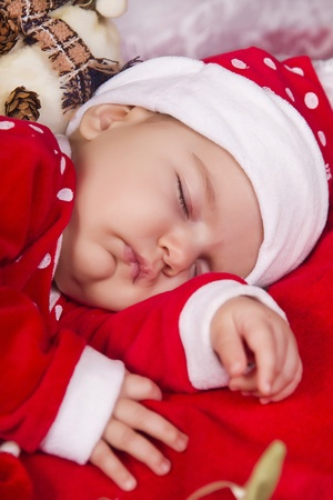 View of a newborn baby on a Christmas suit sleeping. Stock Photo - 12979249