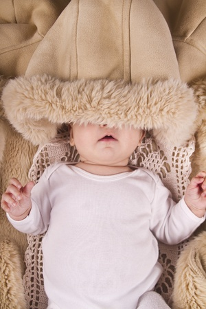 Close up view of a newborn baby inside a winter jacket Stock Photo - 12979098