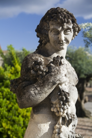 View of a stone statue representing the Greek God of wine, Dionysus. Stock Photo