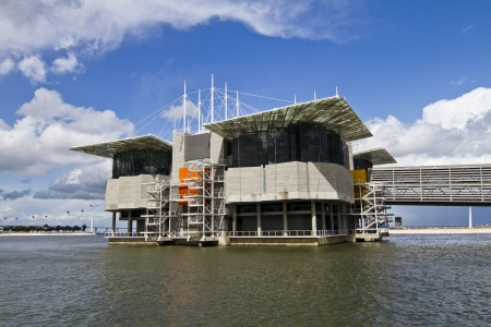 fish exhibition: View of a modern aquarium building suspended on water located in Lisbon, Portugal.
